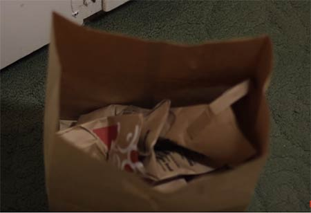 Take the brown paper bag and stuff it with some newspapers or more paper bags.