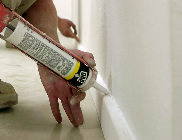 Caulk Along The Baseboard